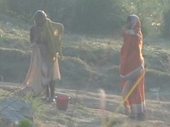 Desi granny changing after disinfected on river